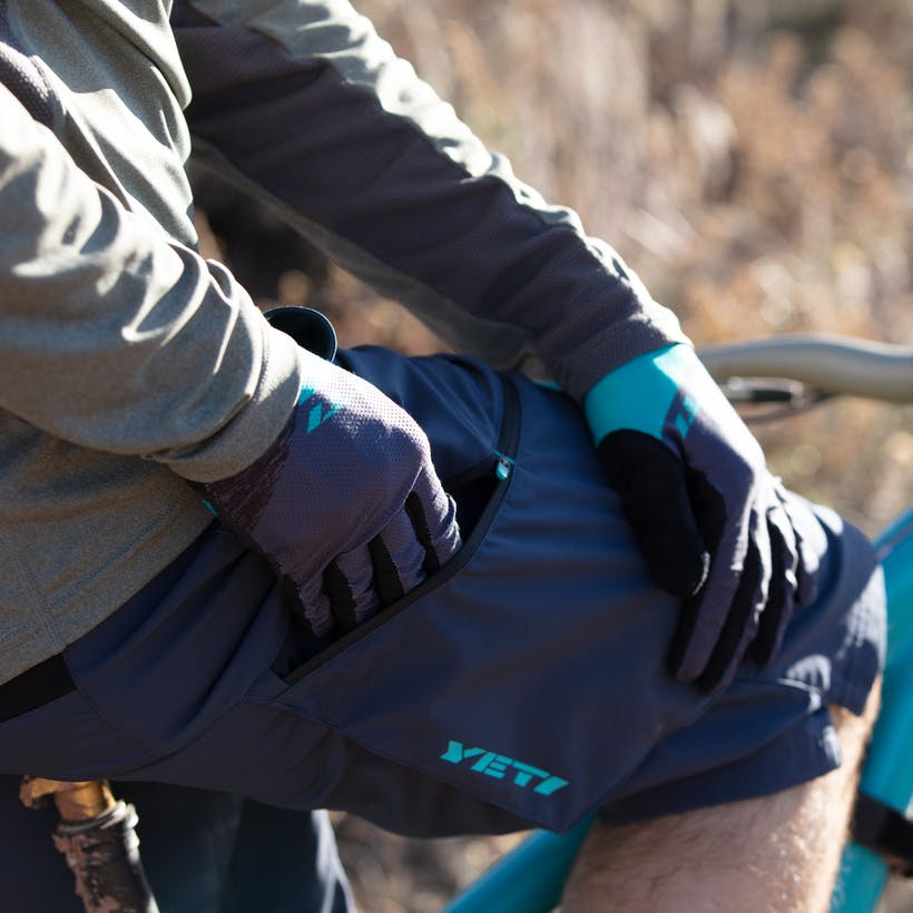 Gloved hand using side pocket of 2020 Freeland 2.0 Short