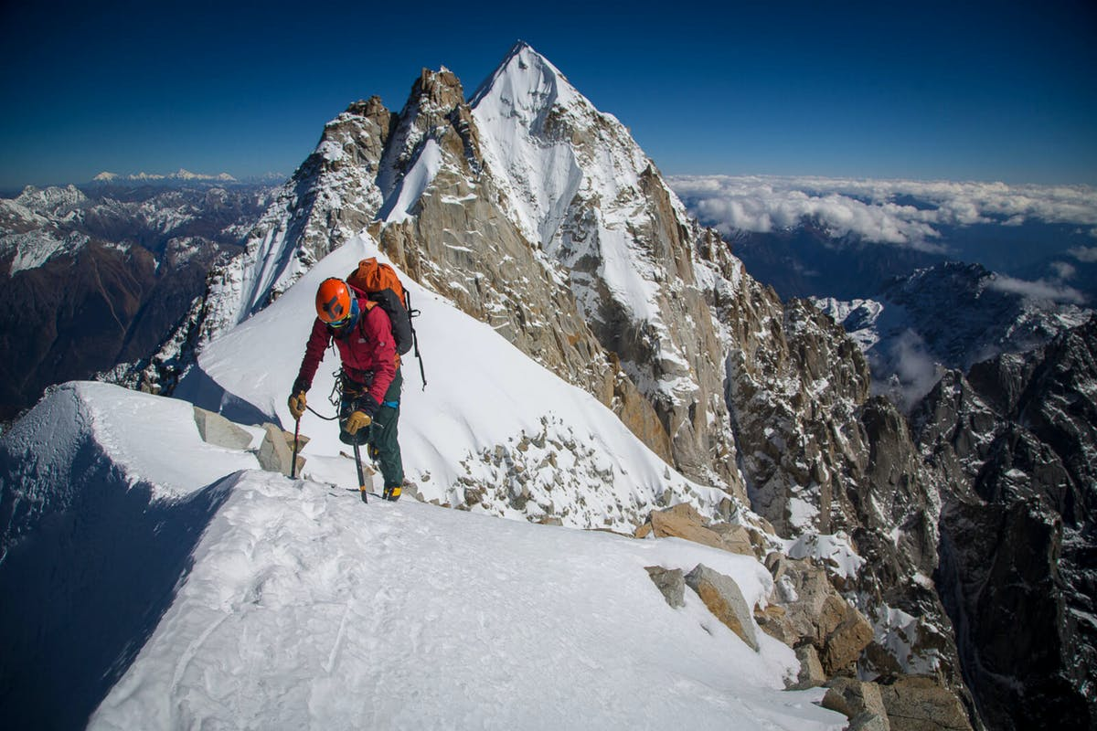 Renan Ozturk climbing on a ridge