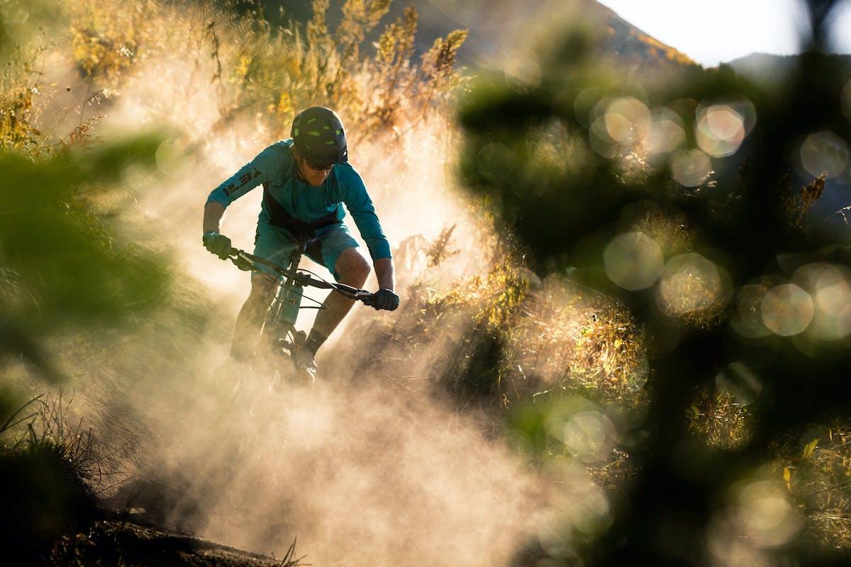 Michael Larsen kicking up dust during golden hour