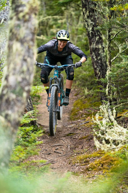 Megan Rose riding classic New Zealand single track.