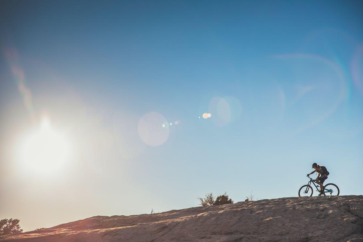 Nichole Baker riding slick rock.