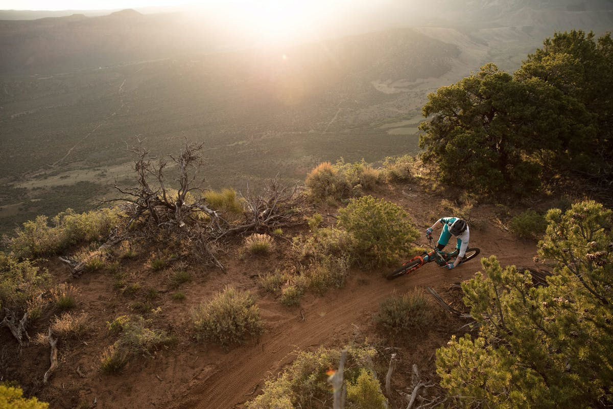 Liz Cunningham cornering near the edge in Moab