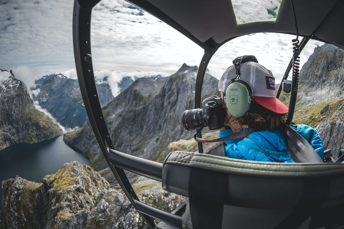 Joey Schusler taking a photo from a helicopter