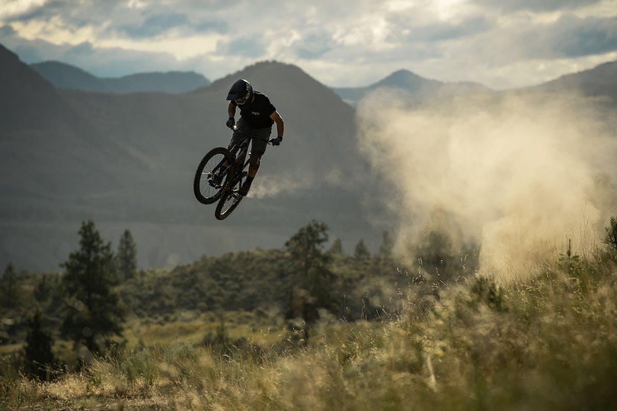 Stu Dickson sending a dusty jump in Kamloops