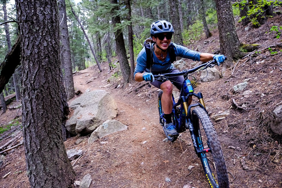 Nichole Baker finding loam covered single track.