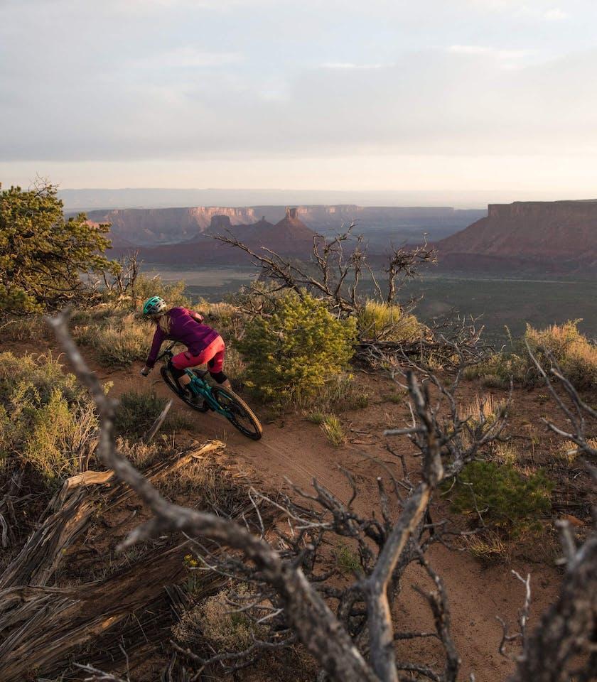 Sarah Rawley descending Porcupine Rim in Moab, UT