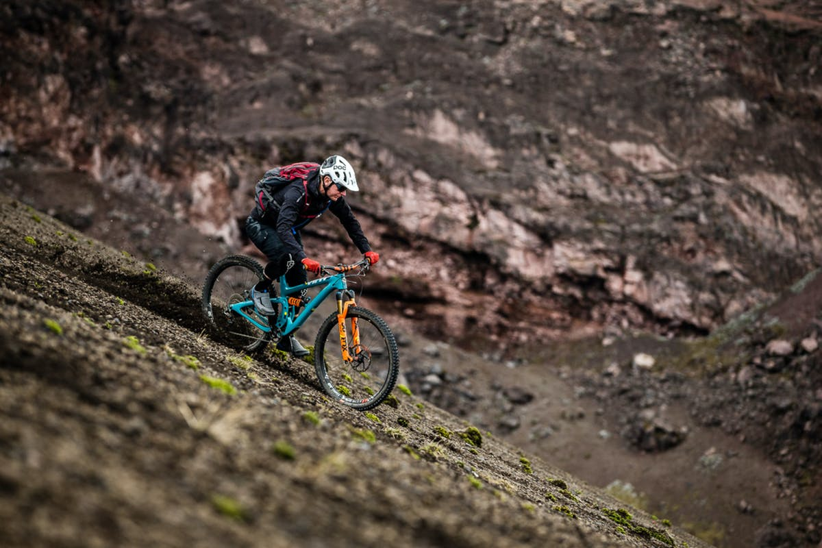 Euan Wilson riding down a scree slope