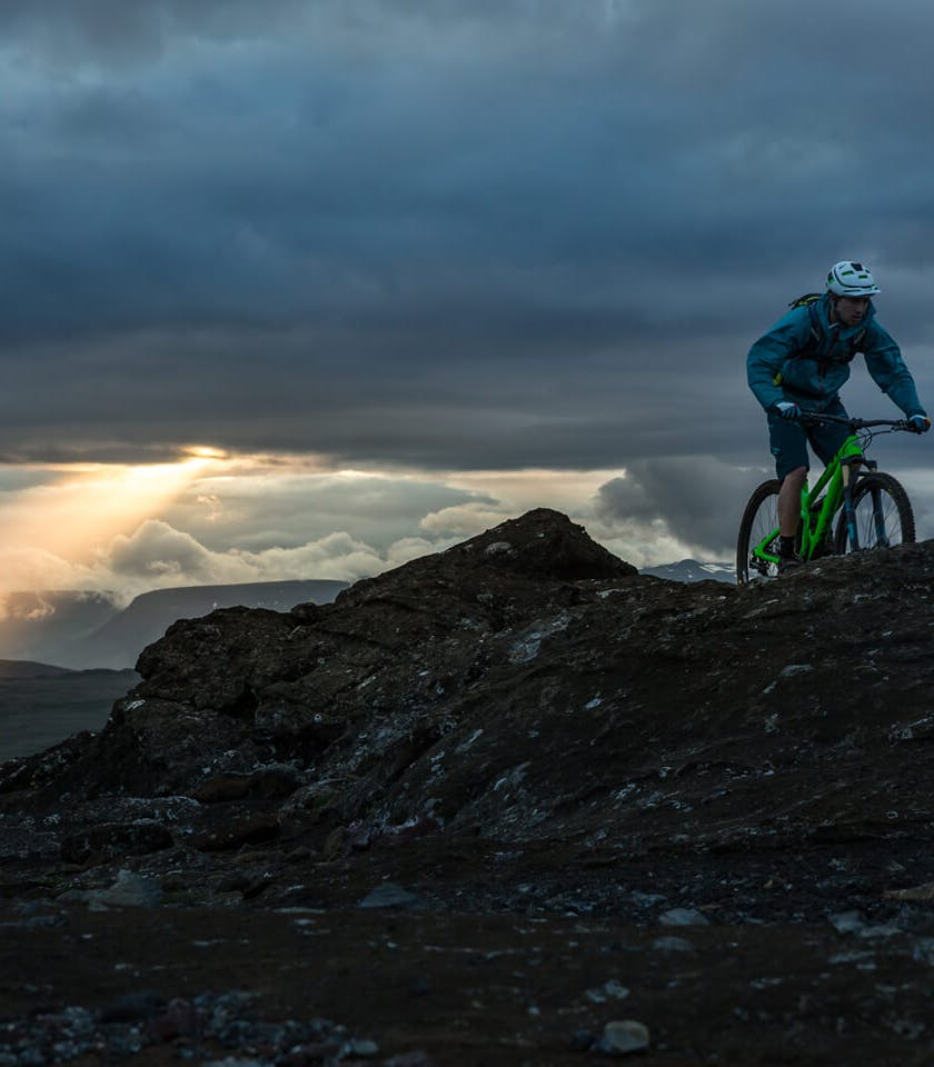 Joey Schusler pedaling the SB4.5 on top of a rocky ridge in Iceland