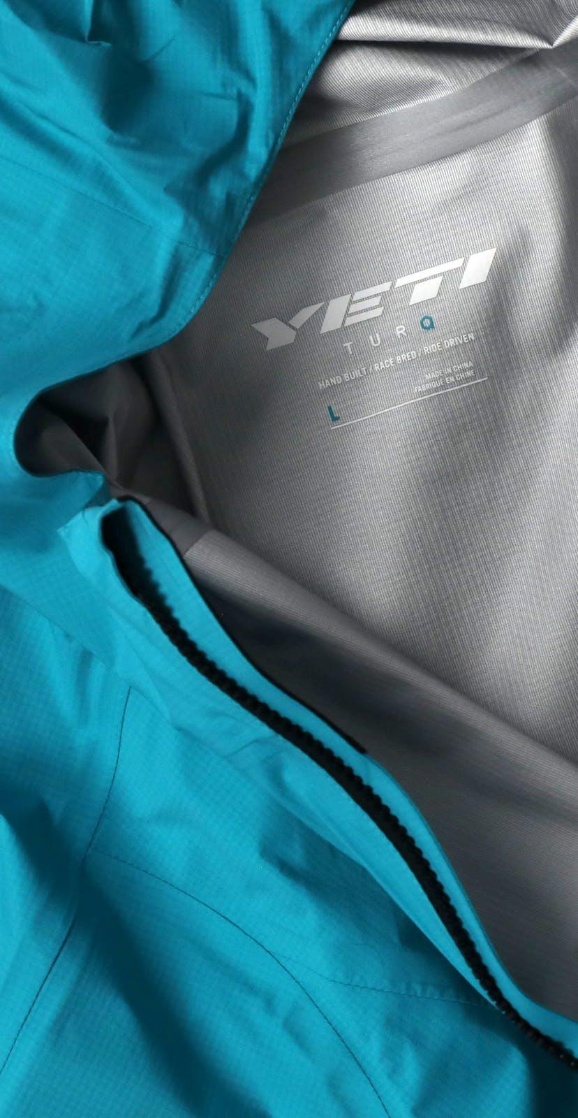 Turq Commit Jacket Detail