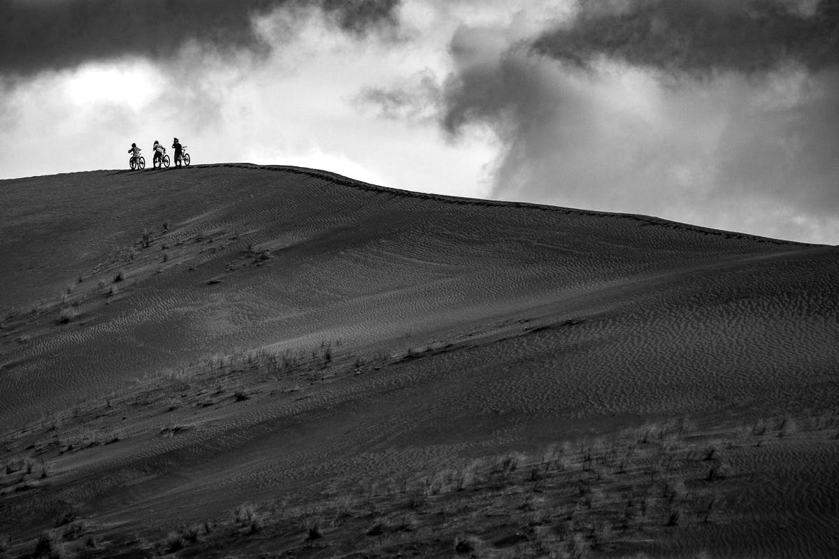 Riders hike a ridgeline
