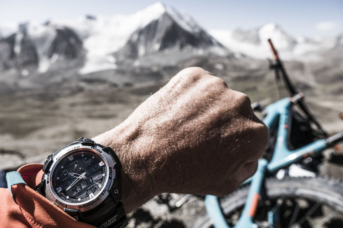 Dan Milner checking his watch, which indicates an elevation of 4310m