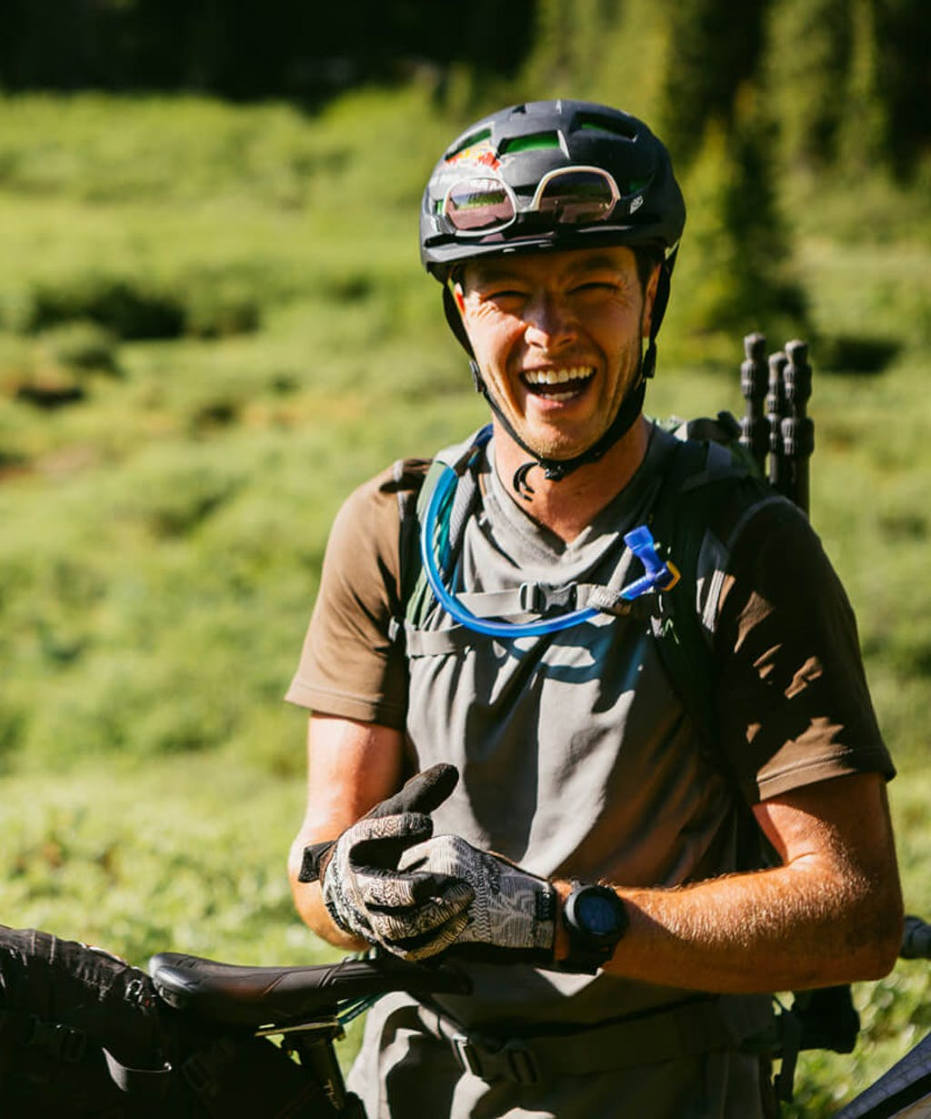 Justin Reiter taking a break next to his ASR after riding a section of the Colorado Trail