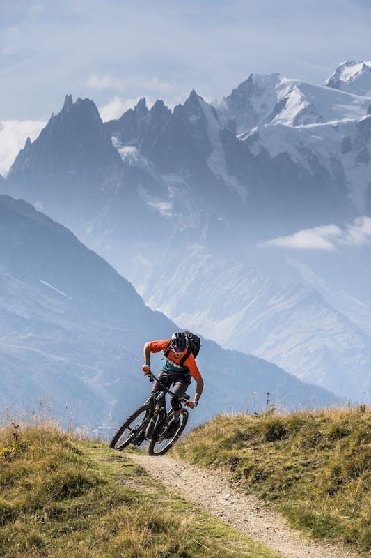 Francesco Gozio riding single track near Mt. Blanc