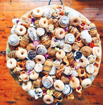 platter up co donuts and scrolls grazing board