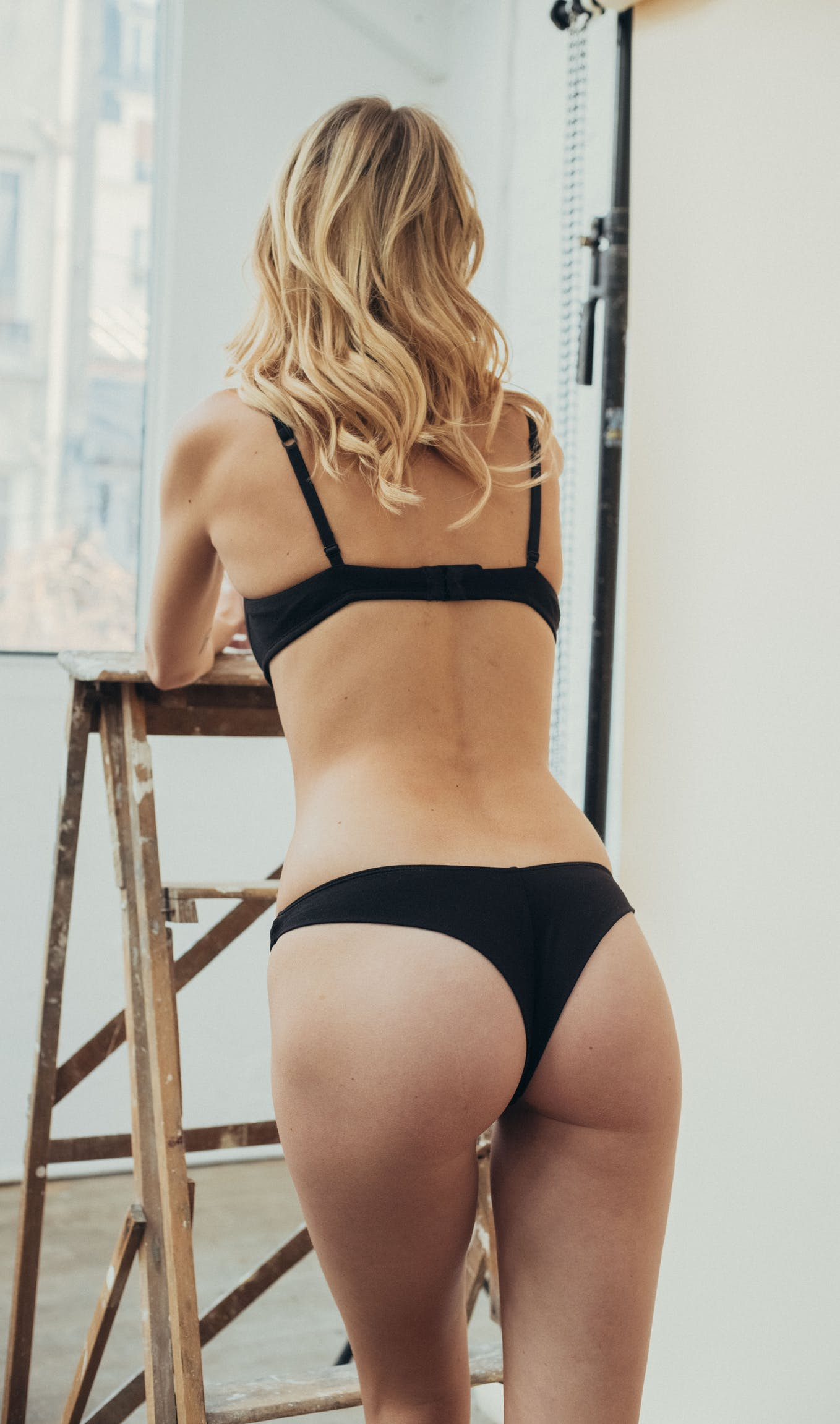 Back view of À fleur de peau Tanga briefs in black