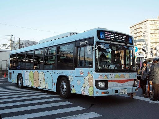 A Japanese bus themed with cute Japanese characters from Sumikkogurashi