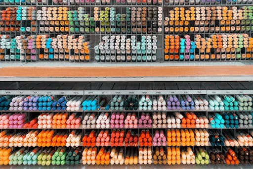 An assortment of colorful Japanese pens, markers and stationary