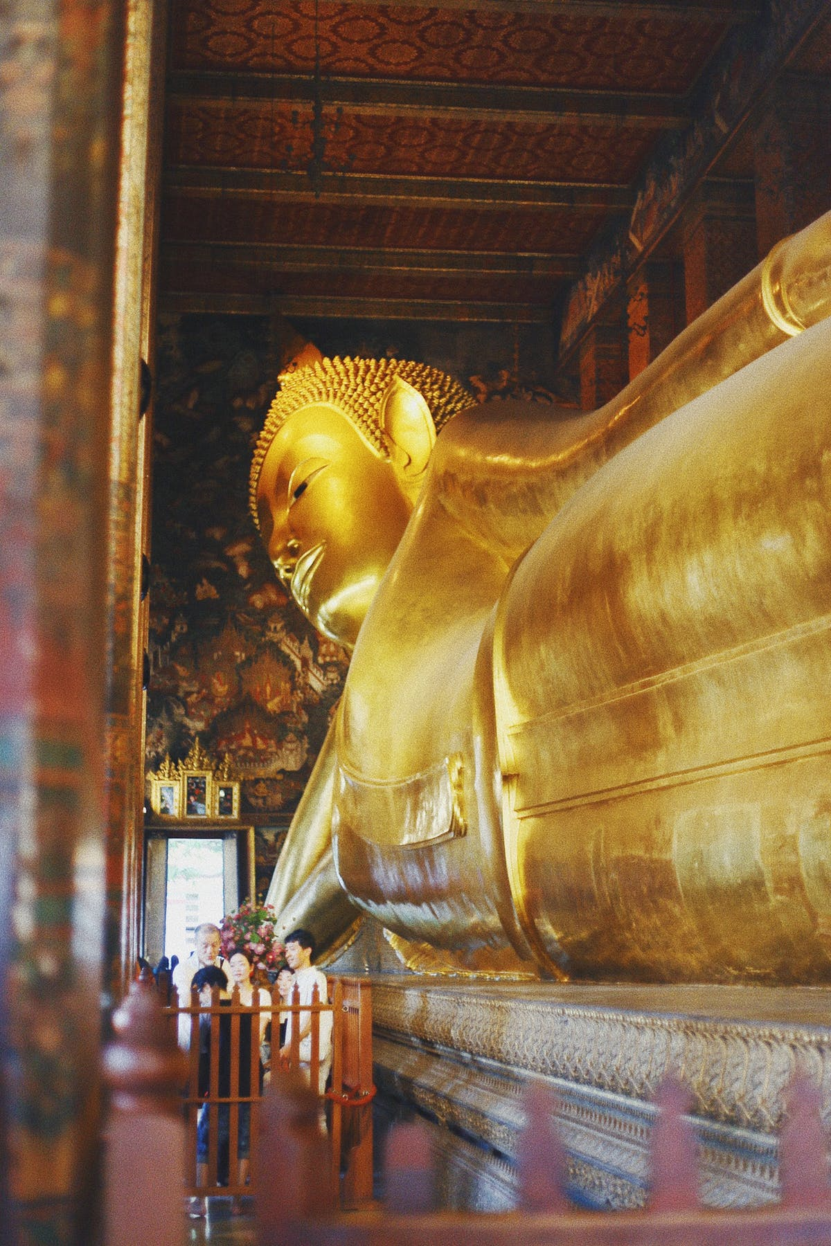 Lying Buddha in gold 45 m long 3/4 view -Photo by Taylor Simpson on Unsplash