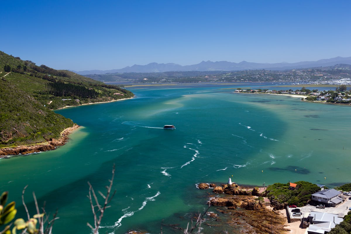 Sky view of Knysna lagoon and its blue, turquoise and green reflections - Image by Ron Porter of Pixabay