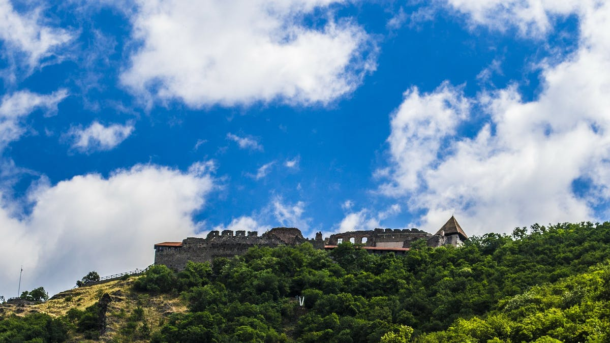 Photo of a castle on top of a hill