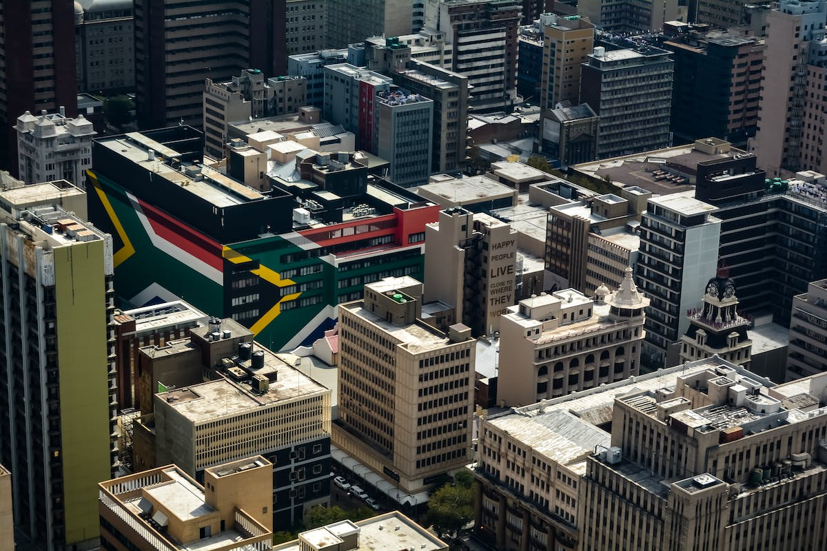 Johannesburg seen from the sky with buildings in the colours of the South African flag - Photo by Jacques Nel on Unsplash
