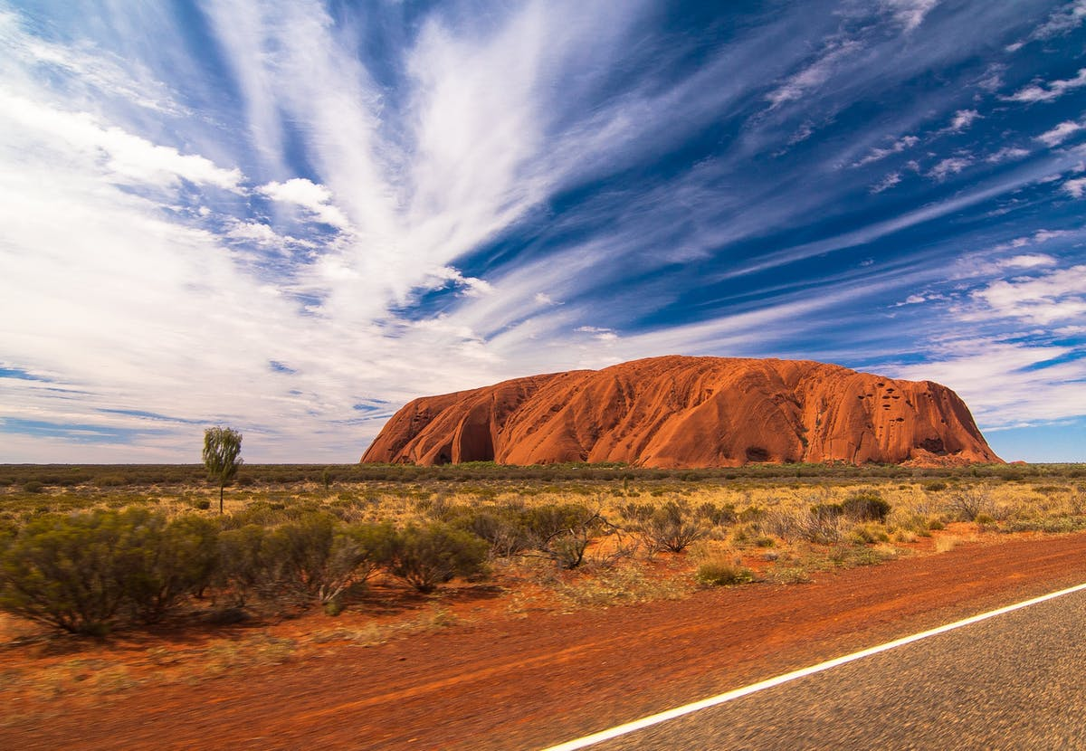 Uluru, the golden and sacred mountain of the Aborigines in Australia.