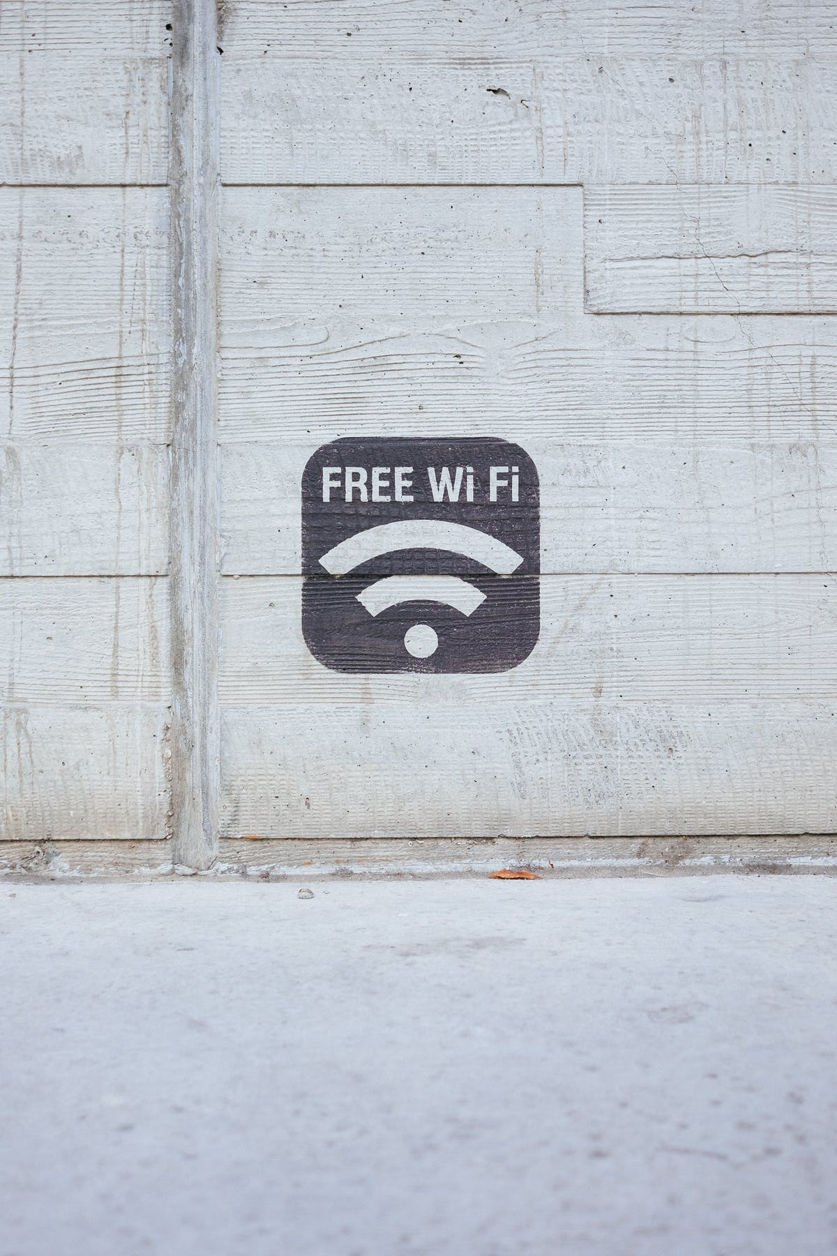 A white wooden wall with the wifi icon and the text