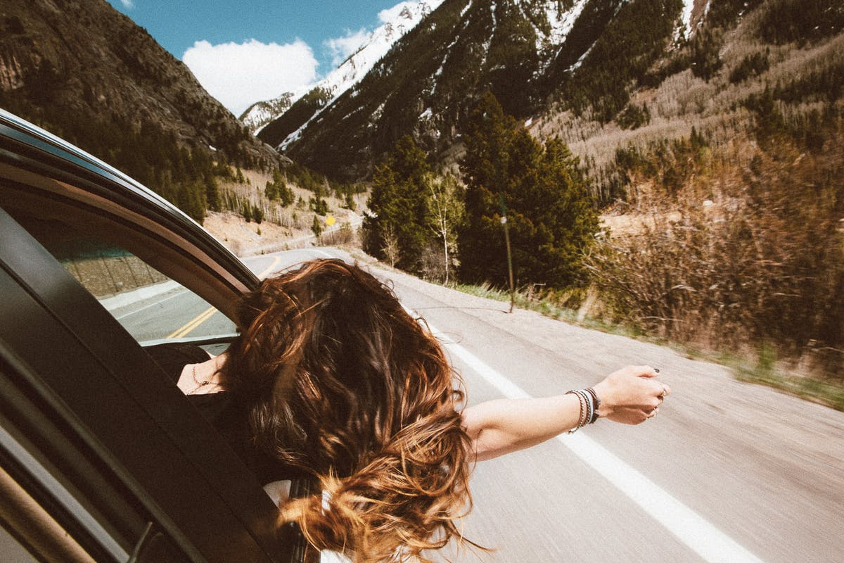 Girl driving in the mountains
