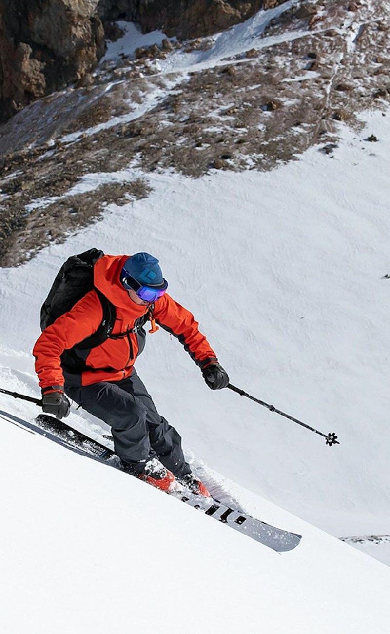 Man skiing down a mountain using Black Diamond gear