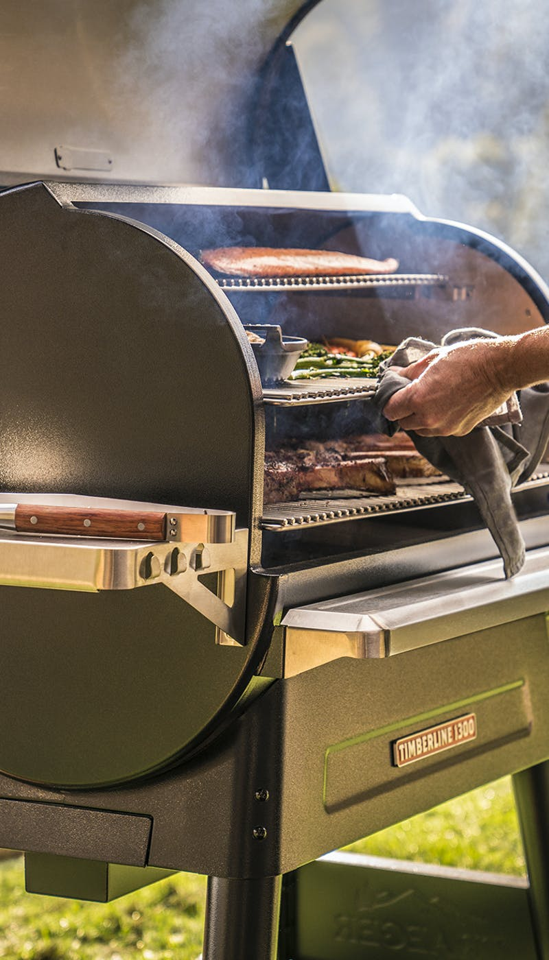 Close up of a man grilling in a Traeger Timerline 1300
