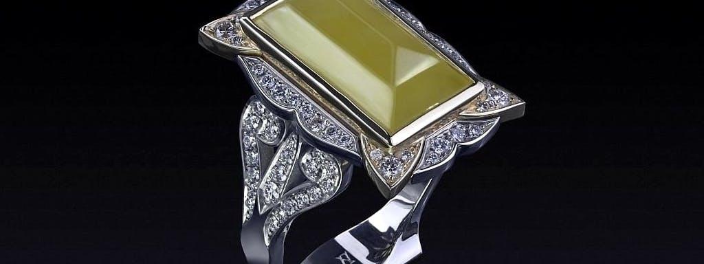 Bursztyn w kształcie kostki cukru z diamentami.