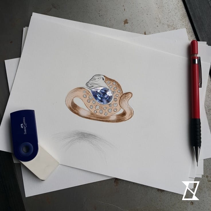 Projekt pierścionka z susłem zwiniętym w kłębek podczas zimowego snu.