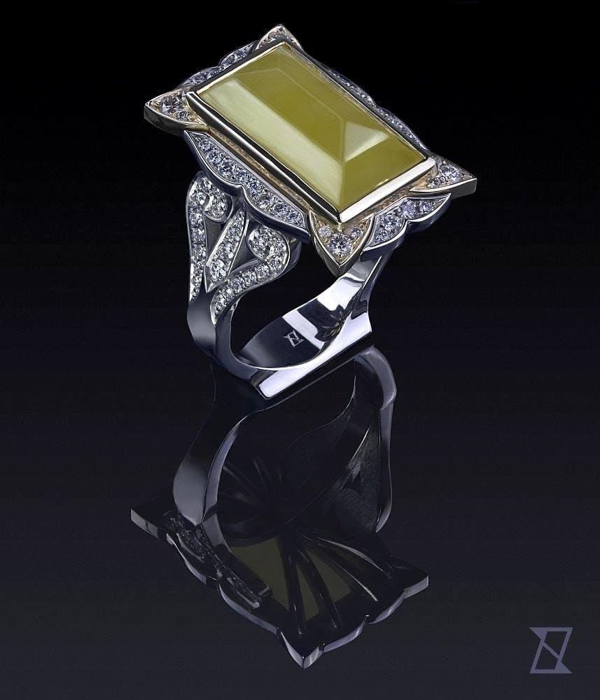 Pierścionek z bursztynem i brylantami w białym złocie.