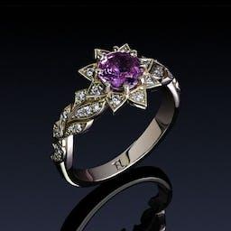 Kwiatowy pierścionek z szafirem i diamentami w różowym złocie.