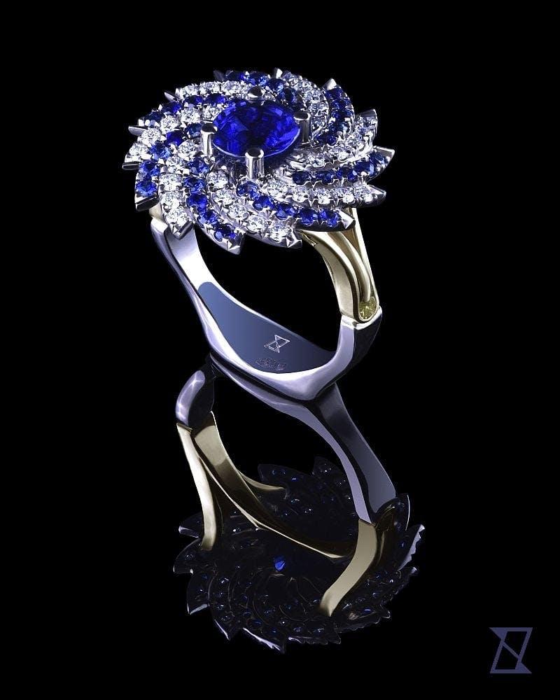 Pierścionek w kształcie spiralnej galaktyki Andromedy z szafirami i brylantami.