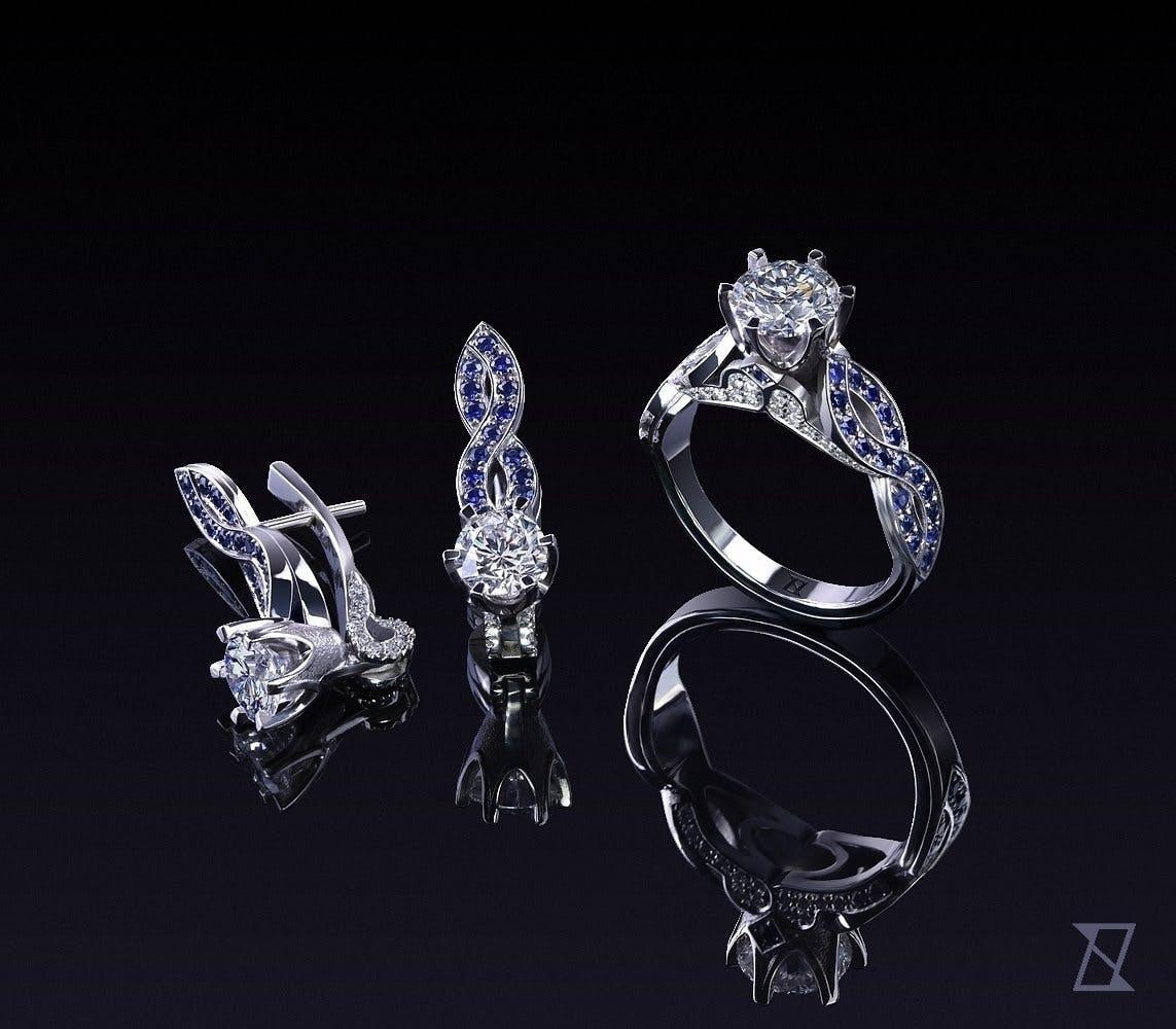 Kolczyki i pierścionek z platyny wysadzane diamentami i szafirami.