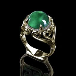 Ring with an emerald sphere with diamonds in yellow gold.