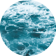 Circle image of the ocean with a teal tinted filter over the top