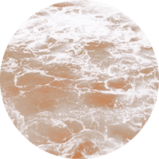 Circle image of the ocean with an orange coloured filter over the top