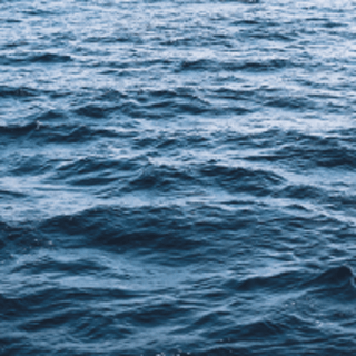 Square image of the ocean tinted teal
